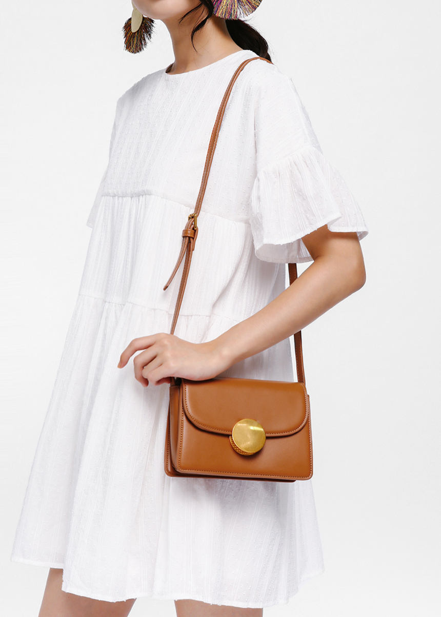 Magella Circle Clasp Crossbody Bag
