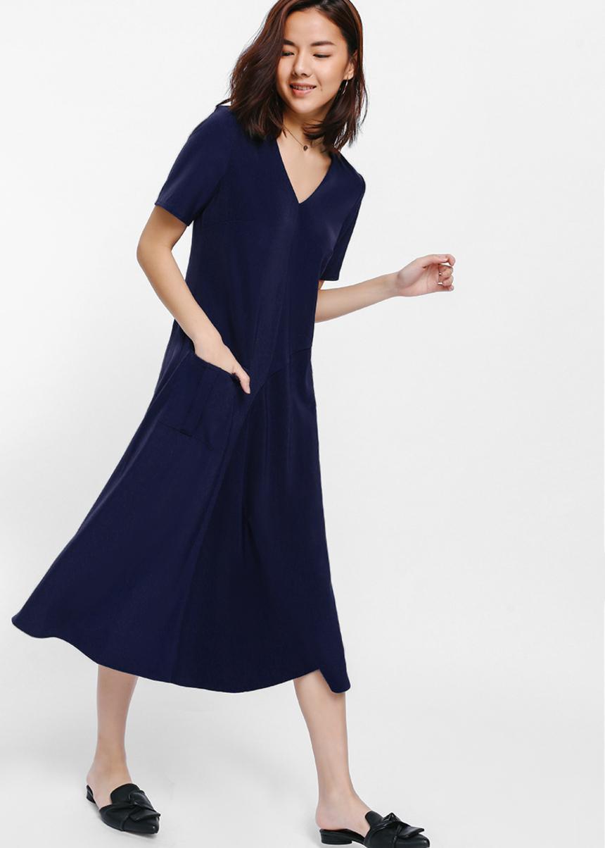 Qilst Asymmetrical Pocket Midi Dress